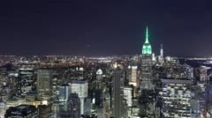 Empire state building night light view from top of the rock 4k time lapse Stock Footage
