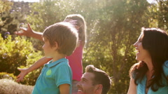 Slow motion of family playing with bubbles in park Stock Footage