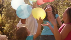 Family in park playing with balloons. Stock Footage