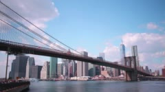 Manhattan view through brooklyn bridge 4k time lapse from new york Stock Footage