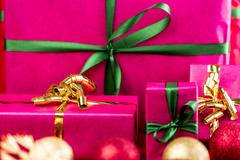 four xmas presents wrapped in plain magenta. - stock photo