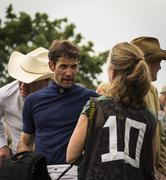 Jockey explains to his friend what happened during the horse race Stock Photos