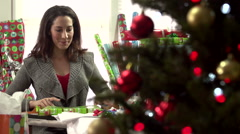 Woman wrapping Christmas present - stock footage