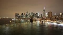 Night light colored manhattan bridge view 4k time lapse Stock Footage
