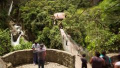 Tourists come and go, Pailon del Diablo waterfall Ecuador, camera pans left Stock Footage