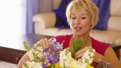 Dolly shot of woman arranging flowers. - stock footage
