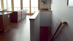 The camera shows off a living room and kitchen in a modern house Stock Footage