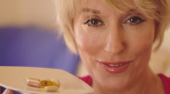 Close up of woman taking vitamin pill. - stock footage
