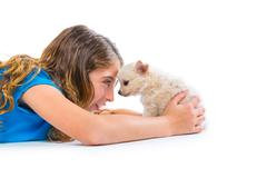 Relaxed kid girl and puppy chihuahua dog lying Stock Photos