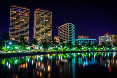 the intracoastal waterway and the skyline at night in west palm beach, florid - stock photo