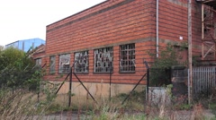 Urban decay old abandoned Victorian factory brick building Stock Footage