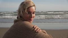 Woman sitting on beach. - stock footage