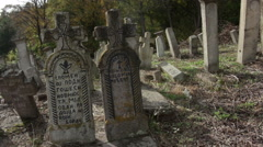 Old village orthodox cemetery in Serbia. Broken and destroyed graves Stock Footage