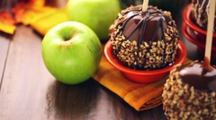 Hand dipped caramel apples decorated for Halloween - stock footage