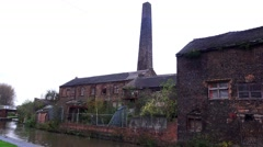 Urban decay old abandoned Victorian factory brick building on canal side Stock Footage