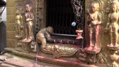 Monkey on Swayambhunath stupa golden  altar in Kathmandu, Nepal Stock Footage