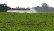 Stock Video Footage of tractor  spraying  fertilizers pesticides on rapeseed field
