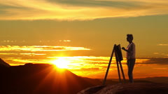 Woman painting landscape picture in sunset. Stock Footage