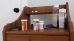 Prescription drugs on a bedside table Stock Footage
