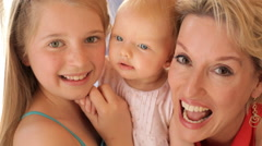 Close up of grandmother and two granddaughters together. Stock Footage