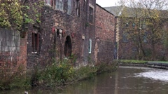Urban decay old abandoned Victorian factory brick building on canal sid Stock Footage