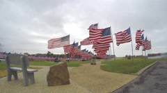 4k Beautiful memorial with several USA flags blowing in the wind Stock Footage