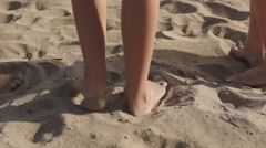 Stock Video Footage of Five children running away from camera down beach to the sea.