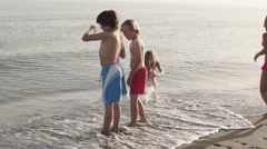 Five children playing in surf. Stock Footage