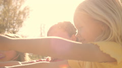 Slow motion of three children playing with bubbles in park. Stock Footage