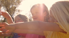 Three children playing with bubbles in park. Stock Footage