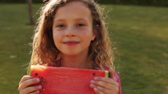 One child eating water melon in park. Stock Footage