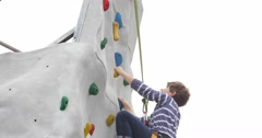 Ultra HD 4K Upward Young Boy Climbing Up Wall Rock Active Hobby Kids Adventures - stock footage