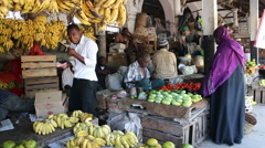 Vendors selling fruit, Stone town fruit market Stock Footage
