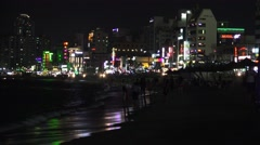 Colorful Waterfront Buildings And Crowds Of People At Night Gwangalli Beach 4K Stock Footage