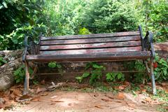 old wooden garden or park bench - stock photo