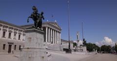 UHD 4K Vienna Austrian Parliament Establishing Shot Busy Street People Walking Stock Footage