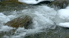 Stock video 4K rock and ice on the freezing mountain river water clear Stock Footage