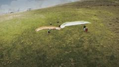 Aerial view of people preparing to paraglide. Spain Stock Footage