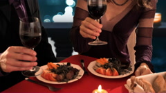 dolly shot of mid aged couple at dinner toasting - stock footage