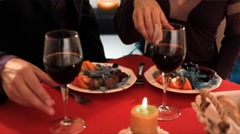 lift up shot of mid aged couple at dinner toasting camera - stock footage