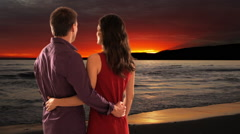 mid aged couple standing in sunset - stock footage