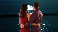 mid aged couple standing in moonlight - stock footage