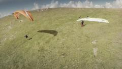 Aerial view of paragliders  taking off. Spain Stock Footage