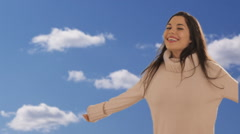Dolly shot of young woman twirling with sky background Stock Footage