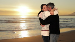 mid aged couple meeting and hugging in park - stock footage