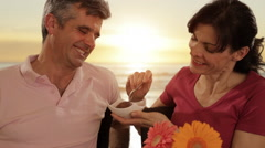 Mid aged couple in beach cafe Stock Footage