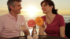 mid aged couple in beach cafe - stock footage