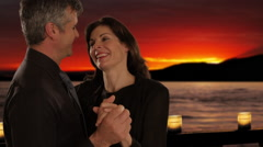 Mid aged couple dancing in sunset Stock Footage