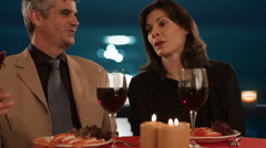 mid aged couple dining in moonlight - stock footage