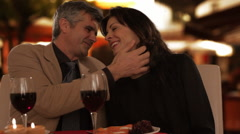 Dolly shot of mid aged couple dining in town Stock Footage